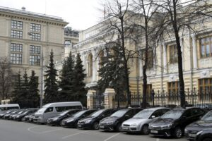 Cars are parked outside the headquarters of the Bank of Russia in Moscow